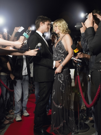 two people with others: Famous Couple Posing on Red Carpet LANG_EVOIMAGES