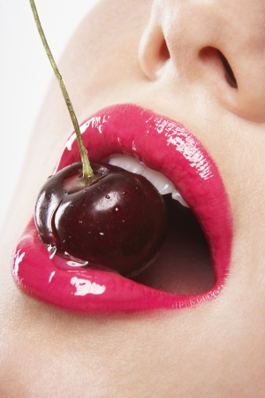 sex appeal: Woman Biting Cherry LANG_EVOIMAGES