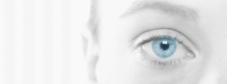 cropped off: Young Womans Eye LANG_EVOIMAGES