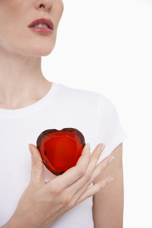 fortysomething: Woman Holding a Jeweled Heart