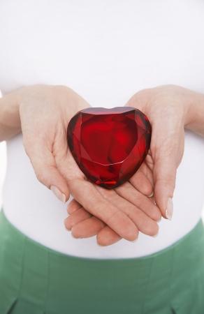 jeweled: Woman Holding a Jeweled Heart