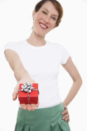 late forties: Woman Holding a Small Gift