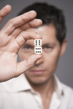 early 40s: Man Holding Dice