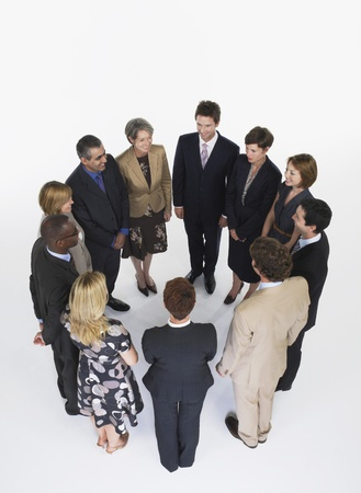racially diverse: Group of Businesspeople in Circle LANG_EVOIMAGES