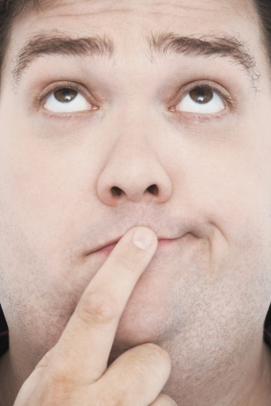 Man with Finger on Mouth