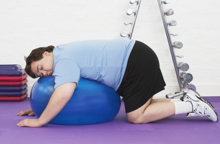 Overweight Man Resting on Exercise Ball Stock Photo - 18896448
