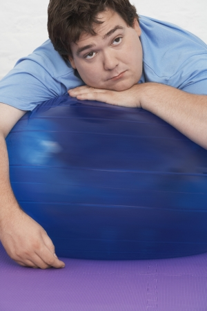 Man Resting on Exercise Ball Stock Photo - 18896449