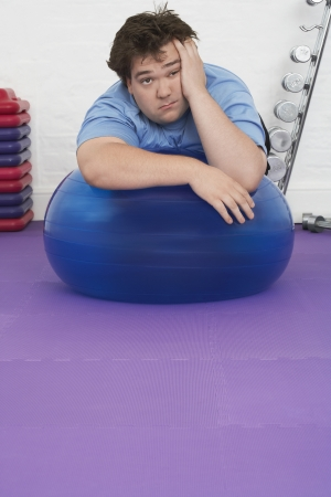 Man Resting on Exercise Ball Stock Photo - 18896450