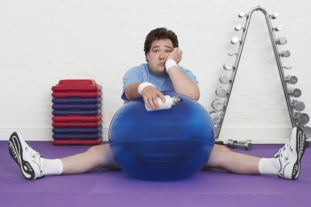 Man Resting on Exercise Ball Stock Photo - 18896451