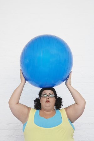 ennui: Overweight Woman Holding Exercise Ball