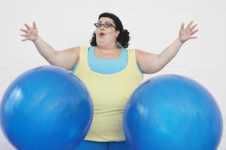 exuberant: Overweight Woman and Exercise Balls LANG_EVOIMAGES