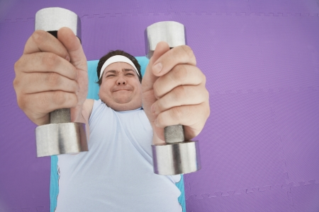 Overweight Man Lifting Weights Stock Photo - 18896469