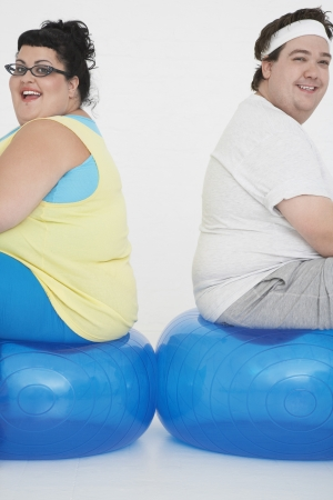 Overweight Couple Resting on Exercise Balls Stock Photo - 18896481