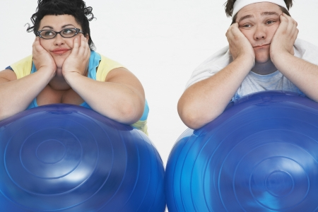 well beings: Overweight Couple Resting on Exercise Balls