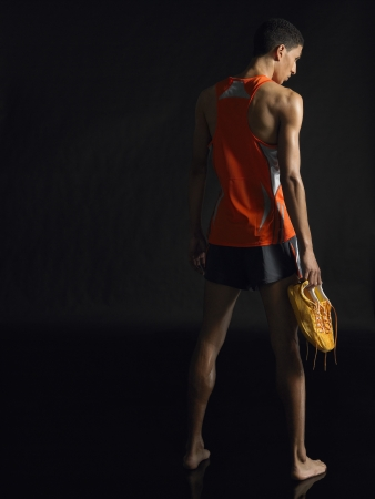 well beings: Athlete Holding Shoes
