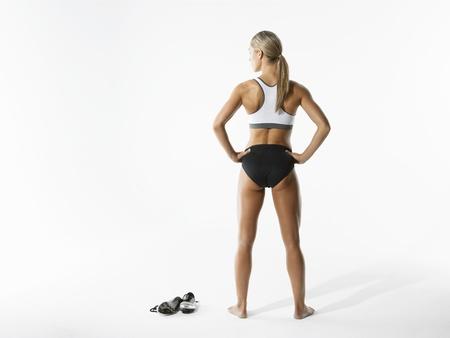 Female Athlete Holding Shoes Stock Photo - 18896563