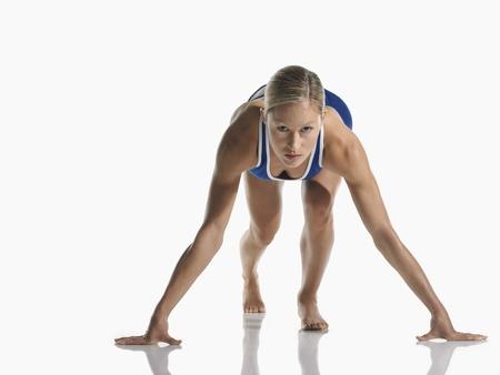 silhouettable: Atleta femminile in posizione di partenza