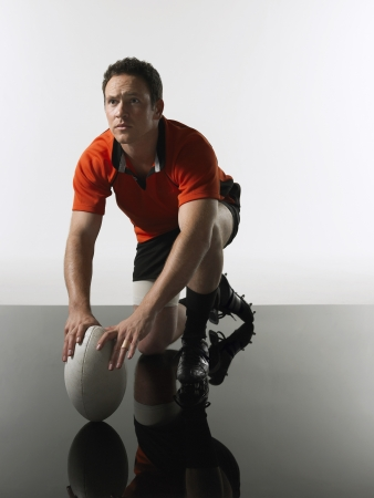 rugby ball: Man Holding Rugby Ball