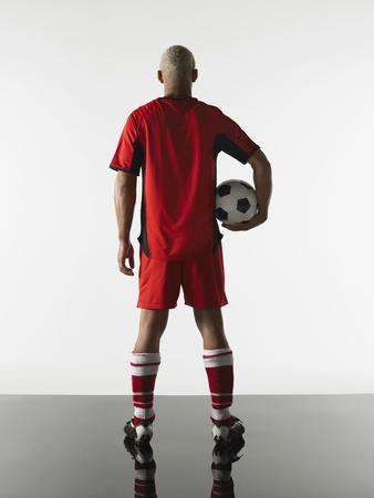silhouettable: Man Holding Soccer Ball