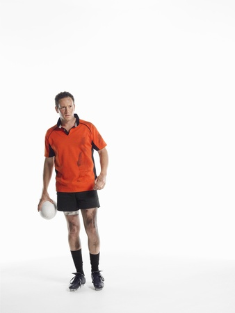 silhouettable: Man Holding Pallone da rugby