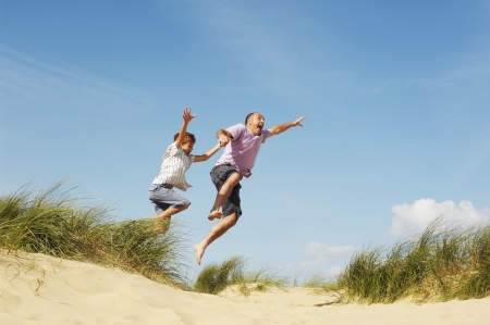 Father and Son Jumping at Beach