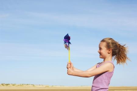 Girl Playing with Pinwheel