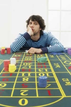decisionmaking: Young Man Gambling