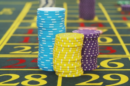 risking: Gambling Chips on a Roulette Table LANG_EVOIMAGES