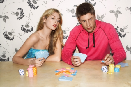 deceptive: Young Couple Gambling LANG_EVOIMAGES