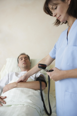 maladies: Nurse Taking Patients Blood Pressure and Pulse