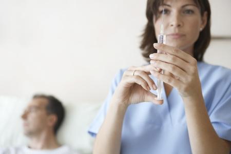 maladies: Nurse Preparing Needle For Injection