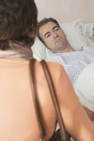 maladies: Woman Visiting Husband in Hospital
