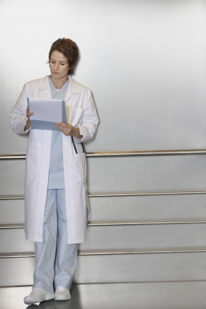 Physician Making Notes in Patient's Chart Stock Photo - 18896887