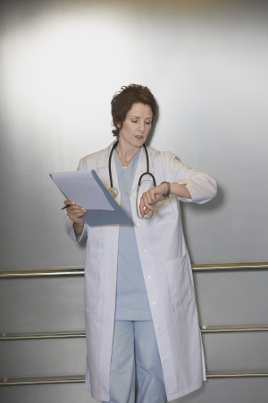 healthcare facilities: Physician Checking Wristwatch