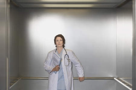 healthcare facilities: Physician Waiting in Elevator