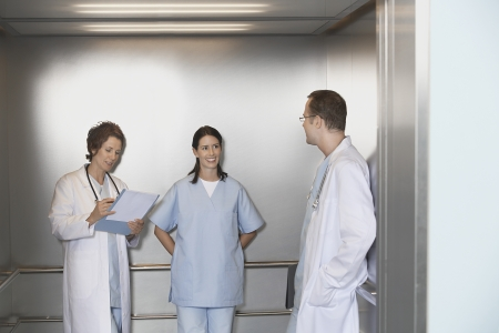 late forties: Physicians in Elevator LANG_EVOIMAGES