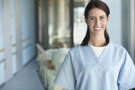 late thirties: Nurse with Patient in Corridor