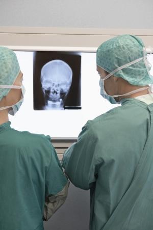 early 40s: Radiologists Examining X-Ray
