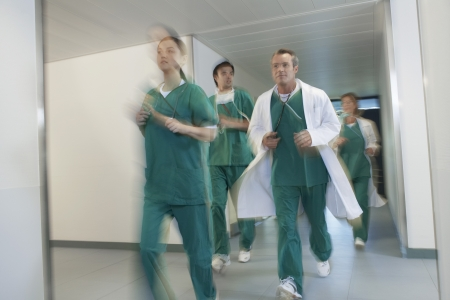 urgent care: Doctors Running in Hospital Corridor
