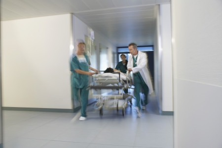 maladies: Doctors With Patient on Stretcher