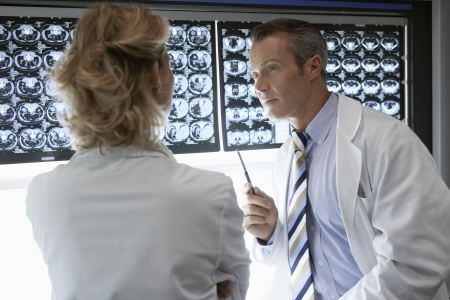 conversational: Doctors Discussing CAT Scan Images