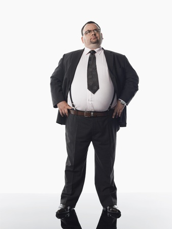 1 man only: Overweight businessman standing with hands on hips