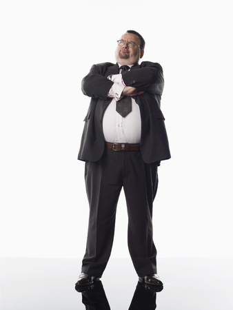 one mid adult man: Overweight businessman standing with arms folded