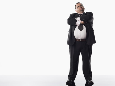 man only: Overweight businessman with arms crossed