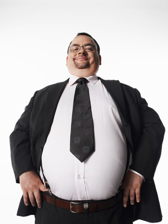 man only: Overweight smiling businessman with hands on hips LANG_EVOIMAGES