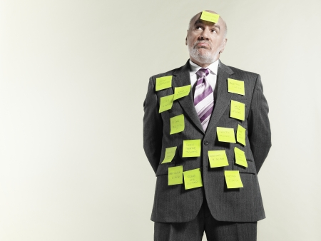 memorise: Businessman covered with sticky notes