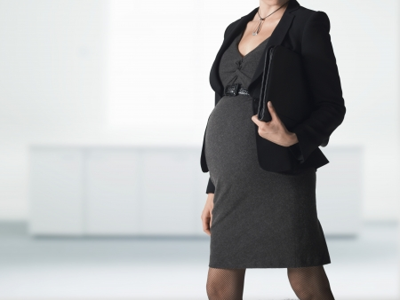 woman only: Pregnant businesswoman mid section