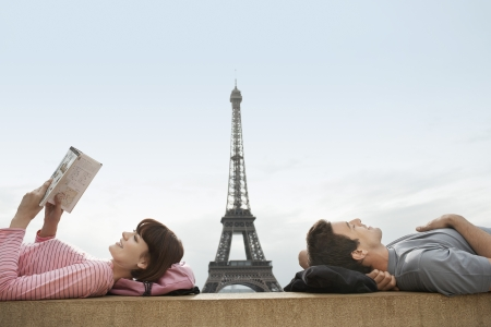 weekend break: Couple lying on ledge of the Trocadero with Eiffel Tower viewed in the background