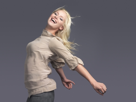 outspread: Smiling woman standing arms outspread side view