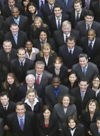 business woman standing: Large group of business people looking up, portrait, elevated view